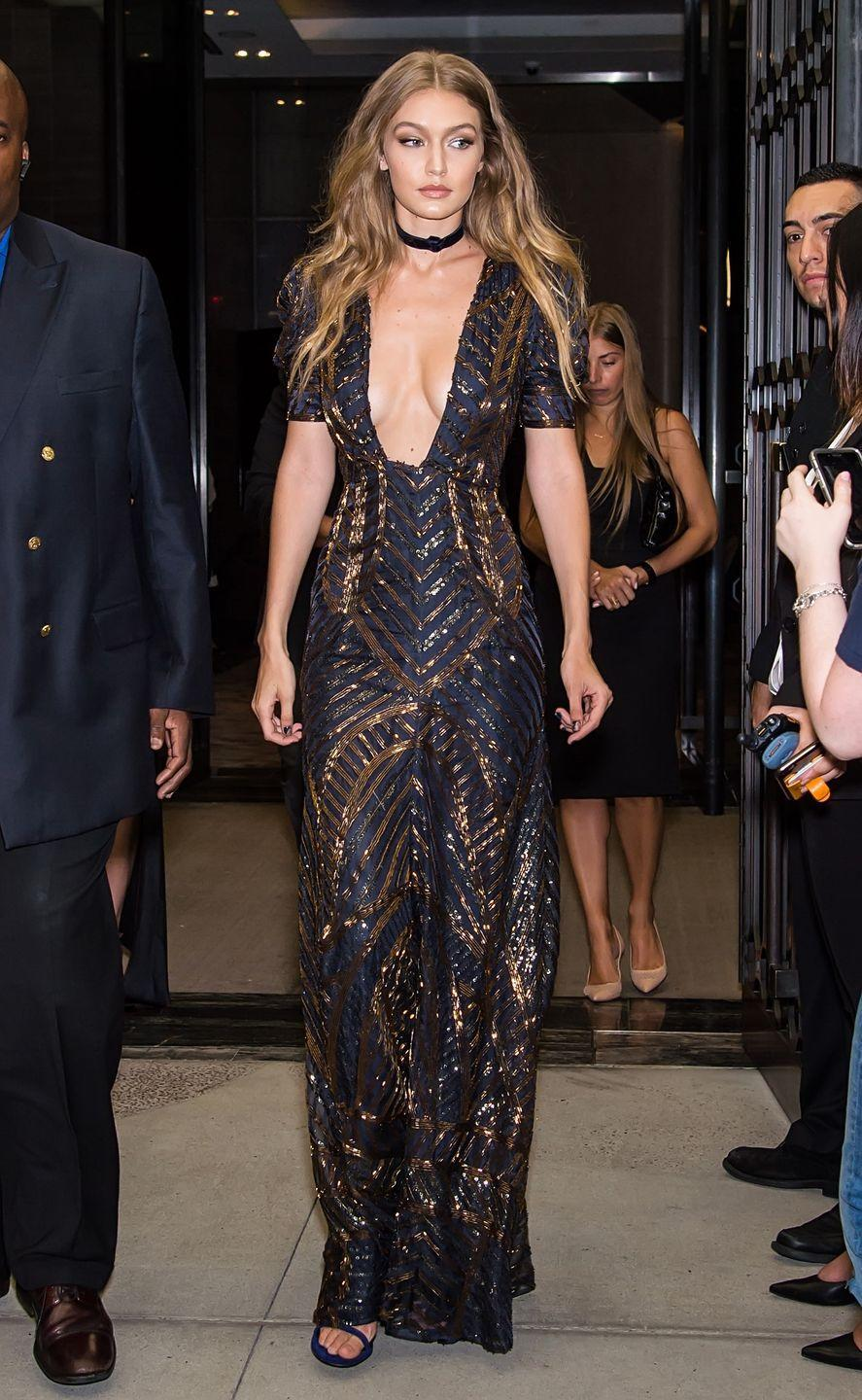 <p>In a plunging Tommy Hilfiger gown, Stuart Weitzman heeled sandals and a velvety choker at the Daily Front Row Fashion Media Awards.</p>