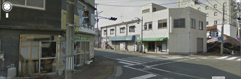 In this computer screenshot made from the Google Maps website provided Wednesday, March 27, 2013, by Google,  deserted buildings are seen in March, 2013, in Namie, Japan, a nuclear no-go zone where former residents have been unable to live since they fled from radioactive contamination from the Fukushima Dai-ichi nuclear power plant two years ago. Google Street View is giving the world a rare glimpse into Japan's eerie ghost town, following the March 2011 earthquake and tsunami which sparked a nuclear disaster that has left the area uninhabitable. The photo technology pieces together digital images captured by Google's camera-equipped vehicle and allows viewers to take virtual tours of locations around the world, including faraway spots like the South Pole and fantastic landscapes like the Grand Canyon, or in this case contaminated deserted townscapes.(AP Photo/Google) EDITORIAL USE ONLY