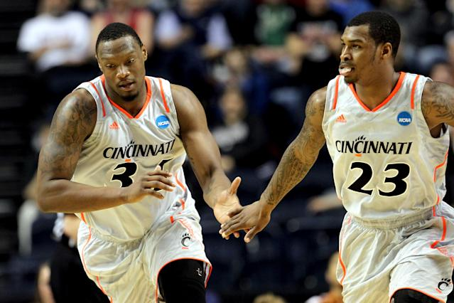 NASHVILLE, TN - MARCH 16: Yancy Gates #34 of the Cincinnati Bearcats celebrates with teammate Sean Kilpatrick #23 after a play against the Texas Longhorns during the second round of the 2012 NCAA Men's Basketball Tournament at Bridgestone Arena on March 16, 2012 in Nashville, Tennessee. (Photo by Jamie Squire/Getty Images)