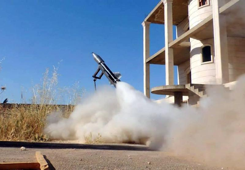 This citizen journalism image provided by Edlib News Network, ENN, which has been authenticated based on its contents and other AP reporting, shows a locally made rocket being fired by Syrian rebels, in Idlib province, northern Syria, Tuesday, June 4, 2013. The Syrian government has denied it is facing a popular uprising since the revolt against Assad's rule erupted in March 2011, saying that the army is fighting foreign-backed terrorists who want to destroy the country. (AP Photo/Edlib News Network ENN)