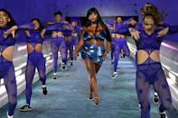<p>The model gave us the blues as she worked the runway.</p>