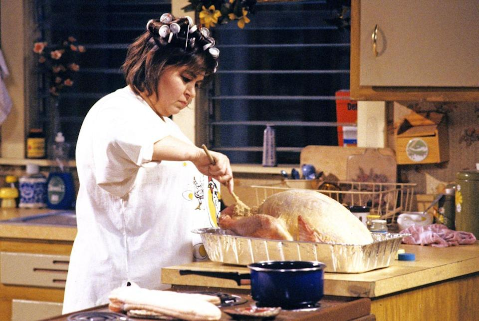 "<p>""Here I am, 5 o'clock in the morning, stuffing bread crumbs up a dead bird's butt."" — Roseanne</p>"