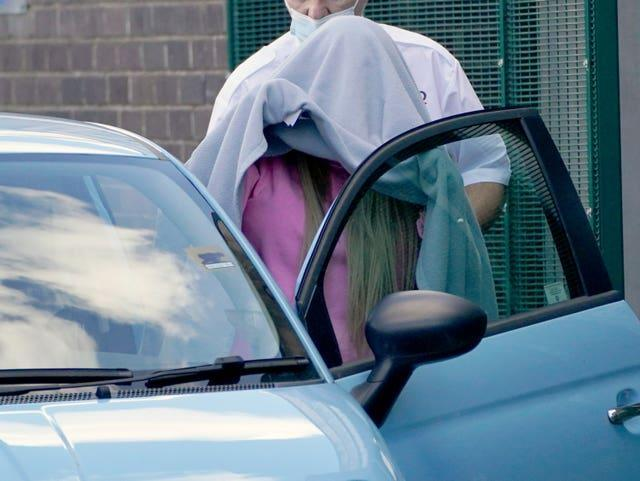Katie Price, covered with a blanket, leaves Crawley Magistrates' Court