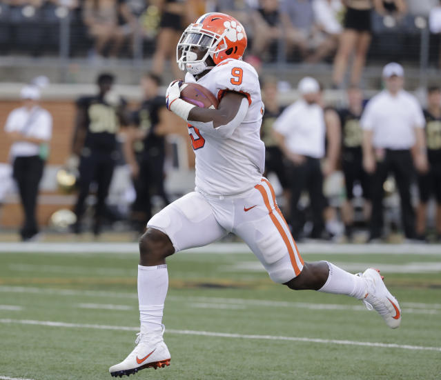 FILE - In this Oct. 6, 2018, file photo, Clemson's Travis Etienne runs for a touchdown against Wake Forest during an NCAA college football game in Charlotte, N.C. Etienne is the one running back left who might be able to break into the field of Heisman Trophy candidates. His biggest issue is touches. The sophomore is averaging just under 13 carries per game, but 8.6 yards per carry with 15 touchdowns. (AP Photo/Chuck Burton, File)