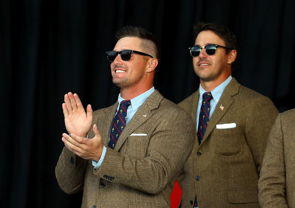 Bryson DeChambeau (pictured left) applauds and Brooks Koepka (pictured right) stands at the opening ceremony for the 43rd Ryder Cup at Whistling Straits on September 23, 2021 in Kohler, Wisconsin.