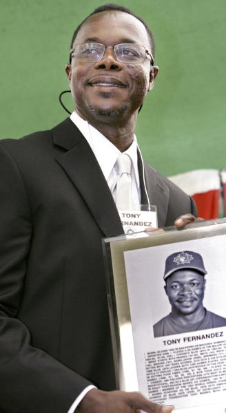 FILE - In this June 28, 2008, file photo, former Toronto Blue Jays player Tony Fernandez attends the Canadian Baseball Hall of Fame & Museum ceremony in St. Marys, Ontario. Former All-Star shortstop Fernandez remained on a life support system Sunday, Feb. 16, 2020, pending a decision by his family on how to proceed, the director of his foundation said. He had been in a medically induced coma, said Imrad Hallim, the director and co-founder of the Tony Fernndez Foundation. Fernandez was ill with a kidney disease for years and waiting for a transplant. (Ken Wightman, London Free Press/Canadian Press via AP, File)