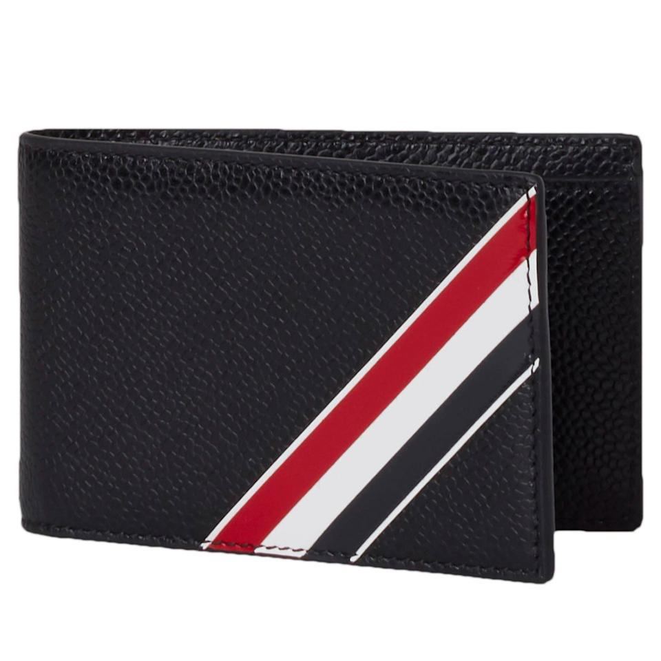 """<p><strong>Thom Browne</strong></p><p>nordstrom.com</p><p><strong>$490.00</strong></p><p><a href=""""https://go.redirectingat.com?id=74968X1596630&url=https%3A%2F%2Fwww.nordstrom.com%2Fs%2Fthom-browne-stripe-leather-bifold-wallet%2F5602303&sref=https%3A%2F%2Fwww.esquire.com%2Fstyle%2Fmens-accessories%2Fg35924710%2Fmens-luxury-wallets%2F"""" rel=""""nofollow noopener"""" target=""""_blank"""" data-ylk=""""slk:Shop Now"""" class=""""link rapid-noclick-resp"""">Shop Now</a></p><p>Turns out Browne's signature tricolor stripe looks especially good on a pebble-grain leather wallet.</p>"""