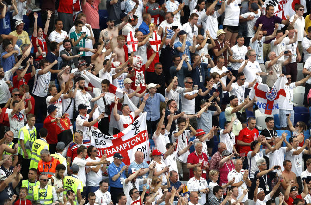 England fans in the stadium cheer the side on at the end of the game