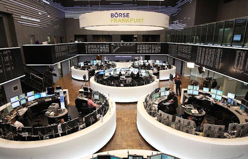 Traders at the Frankfurt Stock Exchange where the DAX 30 index shed 1.29 percent to 11,712.62 points (AFP Photo/Daniel Roland)