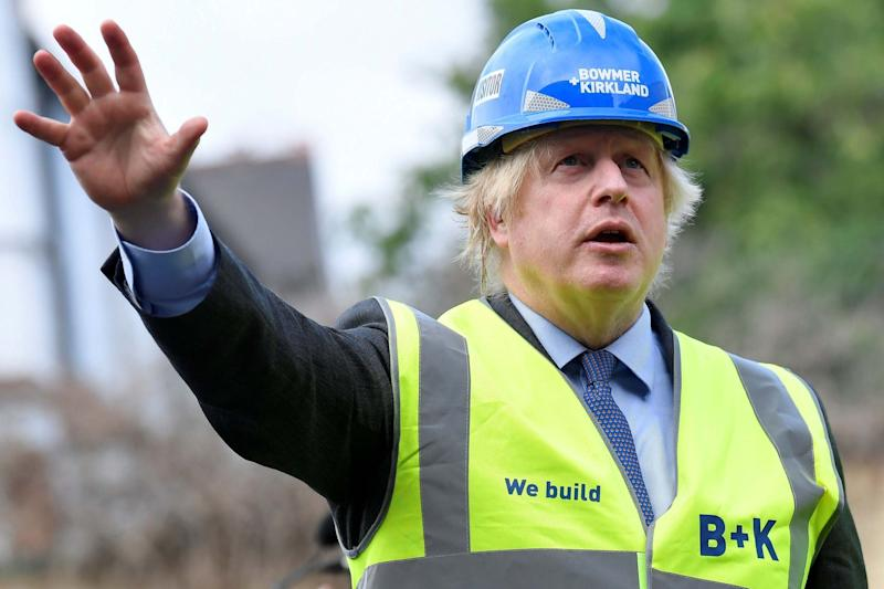 Boris Johnson on the construction site of Ealing Fields High School in west London on Monday: POOL/AFP via Getty Images