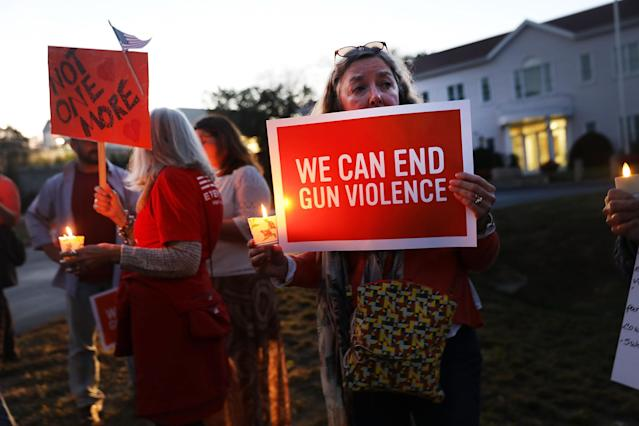 <p>Dozens of people attend a vigil remembering the people killed in Sunday's shooting in Las Vegas and calling for action against guns on Oct. 4, 2017 in Newtown, Conn. (Photo: Spencer Platt/Getty Images) </p>