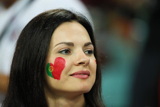 <p>A female fan of Portugal looks on prior to the 2018 FIFA World Cup Russia group B match between Portugal and Spain at Fisht Stadium on June 15, 2018 in Sochi, Russia. (Photo by Matthew Ashton – AMA/Getty Images) </p>