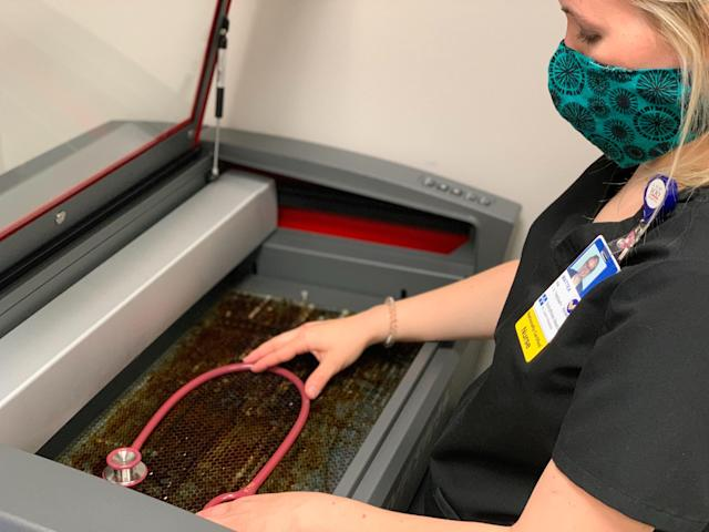 A nurse at UnityPoint Health in Cedar Rapids, Iowa, prepares a stethoscope for laser cutting. (Rose Hedges/UnityPoint)