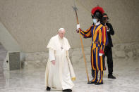 Pope Francis walks past a Vatican Swiss Guard as he arrives for his weekly general audience in the Paul VI hall, at the Vatican, Wednesday, Sept. 8, 2021. (AP Photo/Andrew Medichini)