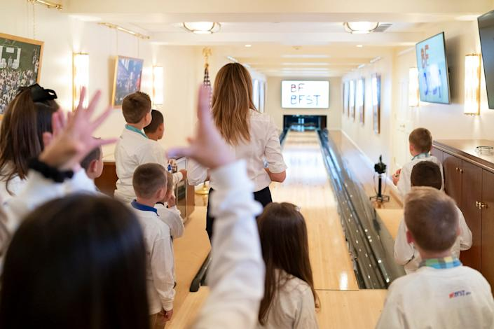 First Lady Melania Trump watches her bowling ball travel down the lane during a Be Best bowling event with children of Secret Service agents Tuesday, April 30, 2019, in the bowling alley of the White House.