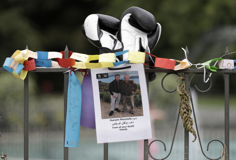 A tribute for mosque shooting victim Hossein Moustafa hangs on a wall at the Botanical Gardens in Christchurch, New Zealand, Thursday, March 21, 2019. Thousands of people were expected to come together for an emotional Friday prayer service led by the imam of one of the two New Zealand mosques where 50 worshippers were killed in a white supremacist attack on Friday March 15. (AP Photo/Mark Baker)