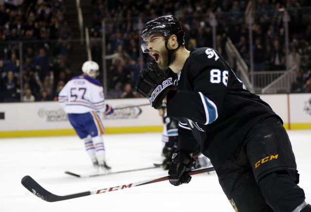 San Jose Sharks' Brent Burns celebrates his goal against the Edmonton Oilers during the first period of an NHL hockey game Thursday, Jan. 2, 2014, in San Jose, Calif. (AP Photo/Marcio Jose Sanchez)
