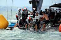 Sailors and rescuers race to save the capsized American Magic from sinking