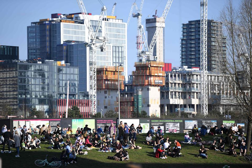 People take advantage of the good weather enjoying the winter sunshine in Hackney WickAFP via Getty Images