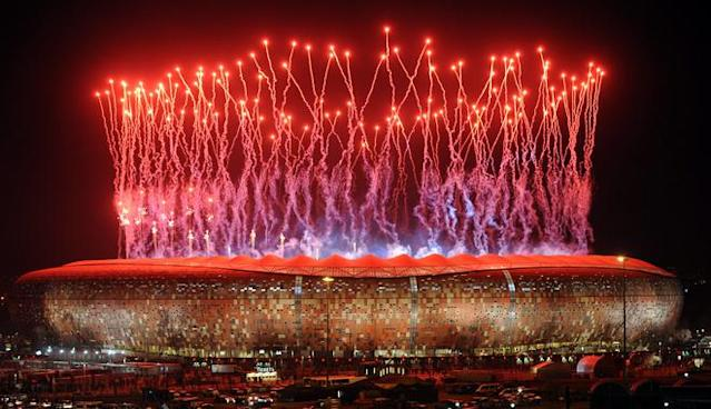 "Fireworks light up the sky over Soccer City stadium in Soweto after the 2010 World Cup football final between the Netherlands and Spain on July 11, 2010. The Africa Cup of Nations champions 2013 will be crowned in the same calabash-inspired Johannesburg stadium as the 2010 World Cup winners, sport minister Fikile Mbalula said on May 4, 2012. ""We will host the opening and closing ceremonies in Johannesburg,"" said Mbalula, ending long speculation and dilly-dallying on the announcement of the five host cities. AFP PHOTO / Monirul BhuiyanMonirul Bhuiyan/AFP/GettyImages"