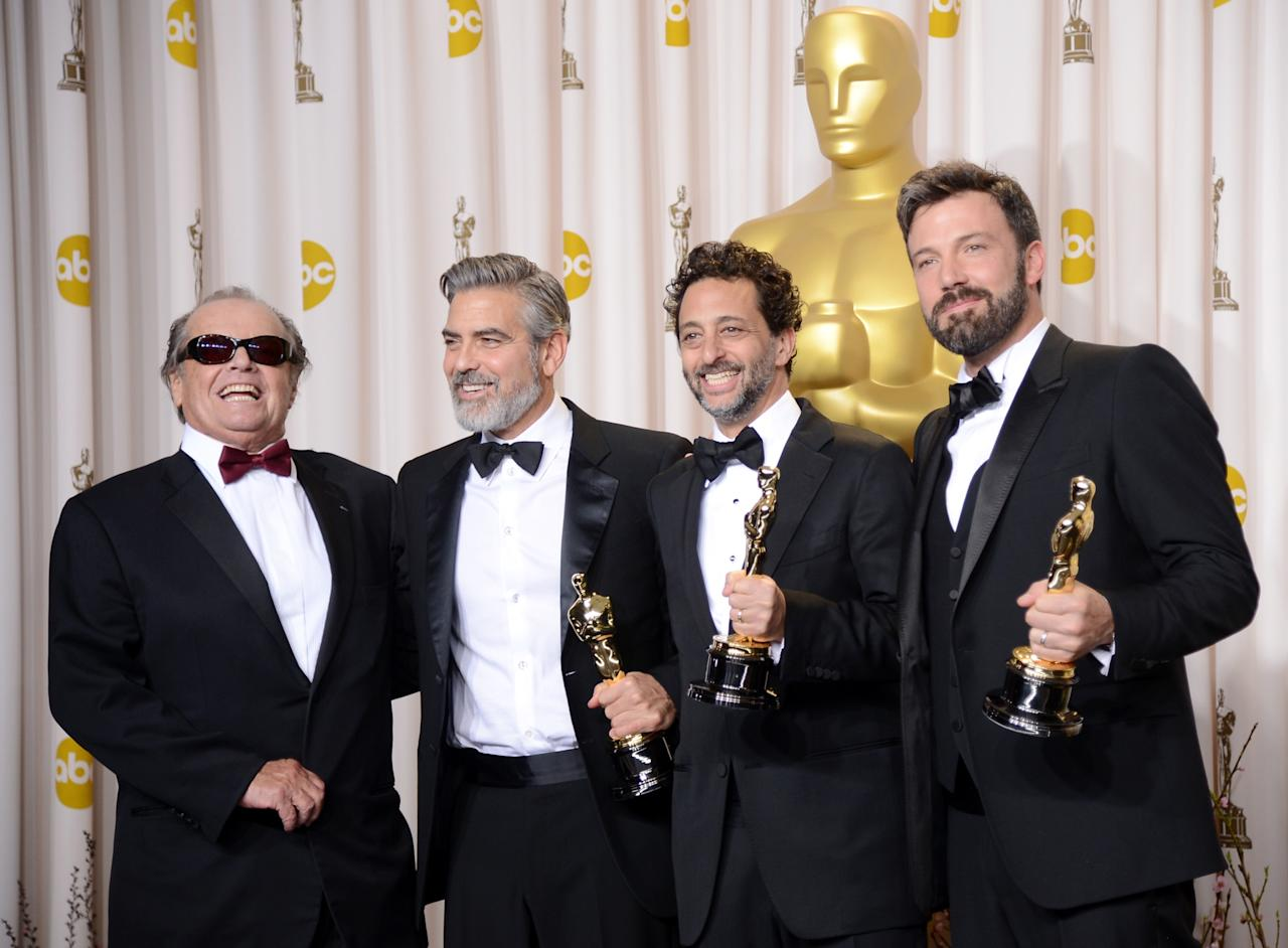 "HOLLYWOOD, CA - FEBRUARY 24:  (L-R) Presenter Jack Nicholson with producers George Clooney and Grant Heslov and actor-producer-director Ben Affleck, winners of the Best Picture award for ""Argo,"" pose in the press room during the Oscars held at Loews Hollywood Hotel on February 24, 2013 in Hollywood, California.  (Photo by Jason Merritt/Getty Images)"