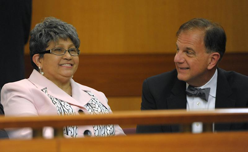 Former Atlanta Public Schools Superintendent Beverly Hall, smiles with attorney J. Tom Morgan before a Fulton County Superior Court hearing for several dozen Atlanta Public Schools educators facing charges alleging a conspiracy of cheating on the CRCT standardized tests in Atlanta, Friday, May 3, 2013. (AP Photo/David Tulis)