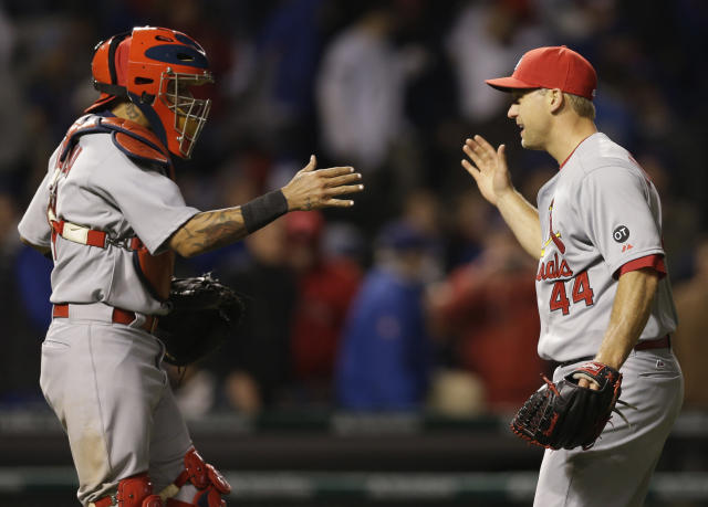 St. Louis Cardinals closer Trevor Rosenthal, right, celebrates with catcher Yadier Molina after the Cardinals defeated the Chicago Cubs 3-0 in a Major League Baseball season-opening game in Chicago, Sunday, April 5, 2015. (AP Photo/Nam Y. Huh)
