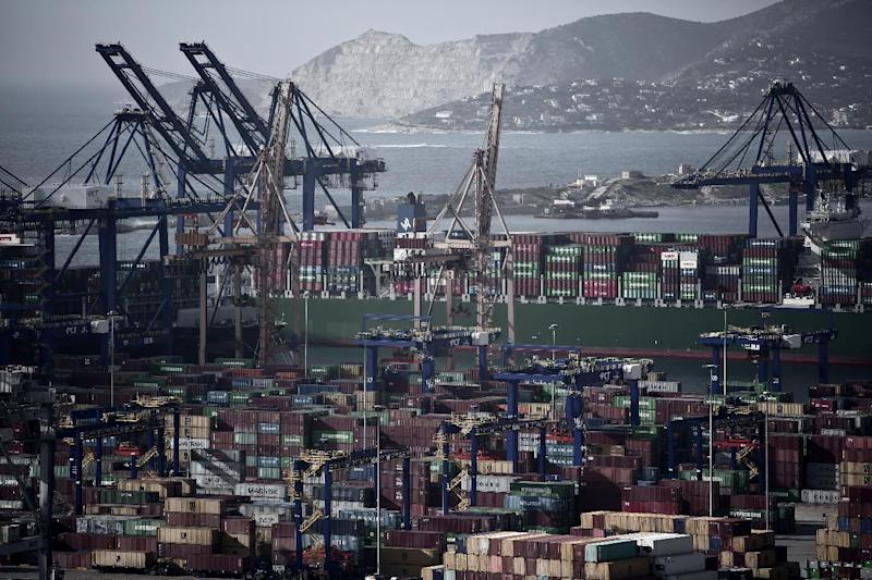 Greece's new government has said it is putting on hold the previous administration's plans to sell a majority stake in the ports of Piraeus (pictured) and Thessaloniki (AFP Photo/Angelos Tzortzinis)