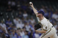 Milwaukee Brewers' Brandon Woodruff pitches during the first inning of a baseball game against the Chicago Cubs Tuesday, June 29, 2021, in Milwaukee. (AP Photo/Aaron Gash)