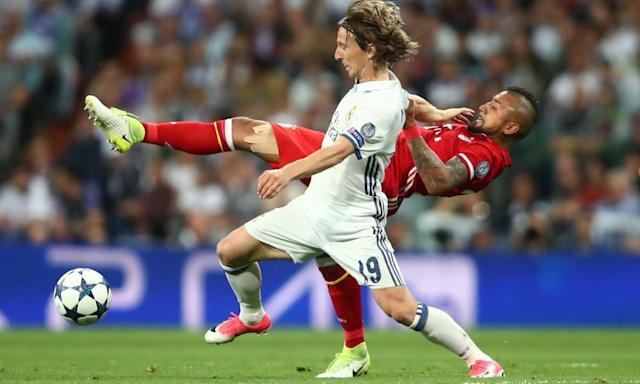 """<span class=""""element-image__caption"""">Arturo Vidal makes one of his typically well-timed and considered challenges on Luka Modric.</span> <span class=""""element-image__credit"""">Photograph: Michael Dalder/Reuters</span>"""