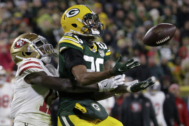Green Bay Packers cornerback Kevin King (20) interests a pass intended for San Francisco 49ers wide receiver Marquise Goodwin (11) during the second half of an NFL football game Monday, Oct. 15, 2018, in Green Bay, Wis. The Packers won 33-30. (AP Photo/Mike Roemer)