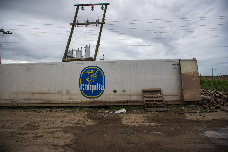 A Chiquita container sits on the side of the road where it was dragged by floodwaters during last year's hurricanes Eta and Iota at a banana packing plant in La Lima, on the outskirts of San Pedro Sula, Honduras, Wednesday, Jan. 13, 2021. The Sula Valley, Honduras' most agriculturally productive, was so heavily damaged that international organizations have warned of a food crisis. (AP Photo/Moises Castillo)