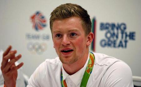 Team GB athlete Adam Peaty speaks at a news conference after returning from the 2016 Rio Olympics, at Heathrow Airport in London, Britain August 23, 2016.REUTERS/Peter Nicholls