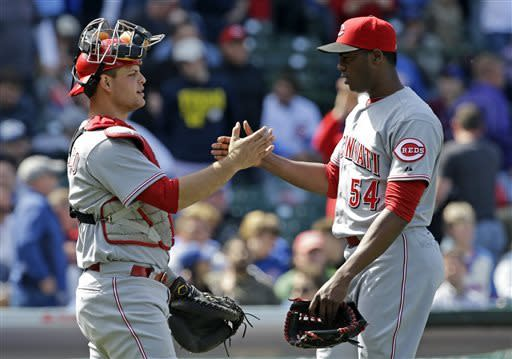 Cincinnati Reds closer Aroldis Chapman, right, celebrates with catcher Devin Mesoraco after the Reds defeated the Chicago Cubs 6-4 in a baseball game in Chicago, Saturday, May 4, 2013. (AP Photo/Nam Y. Huh)