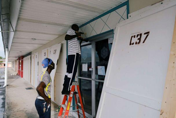 PHOTO: Workers install storm shutters before the arrival of Hurricane Dorian in Marsh Harbour, on the Great Abaco Island, Bahamas, August 31, 2019. (Dante Carrer/Reuters)