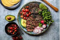 """<p>You'll want to run and fire up your grill after reading through this recipe. A mixture of dry peppers, aromatics, citrus, and spices make it worth the extra work.</p><p><strong><a href=""""https://thepioneerwoman.com/food-and-friends/carne-asada-101/"""" rel=""""nofollow noopener"""" target=""""_blank"""" data-ylk=""""slk:Get the recipe."""" class=""""link rapid-noclick-resp"""">Get the recipe.</a></strong></p><p><a class=""""link rapid-noclick-resp"""" href=""""https://go.redirectingat.com?id=74968X1596630&url=https%3A%2F%2Fwww.walmart.com%2Fip%2FThe-Pioneer-Woman-Timeless-Beauty-Pre-Seasoned-Plus-20-Cast-Iron-Double-Griddle%2F117723541&sref=https%3A%2F%2Fwww.thepioneerwoman.com%2Ffood-cooking%2Fmeals-menus%2Fg32188535%2Fbest-grilling-recipes%2F"""" rel=""""nofollow noopener"""" target=""""_blank"""" data-ylk=""""slk:SHOP GRIDDLES"""">SHOP GRIDDLES</a></p>"""