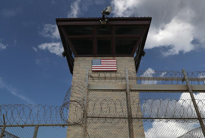 A guard tower stands at the entrance of the Guantanamo Bay prison