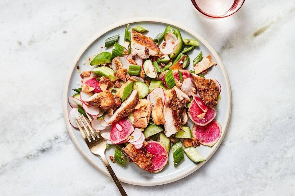 """This salad needs no separate dressing: The warm spiced chicken infuses all of the vegetables with flavor and richness. Skin-on chicken thighs contribute a little fat to that dressing, but you can use skinless if you want—just plan on adding an extra glug or two of oil. <a href=""""https://www.epicurious.com/recipes/food/views/chicken-thighs-with-crunchy-summer-vegetable-salad?mbid=synd_yahoo_rss"""" rel=""""nofollow noopener"""" target=""""_blank"""" data-ylk=""""slk:See recipe."""" class=""""link rapid-noclick-resp"""">See recipe.</a>"""