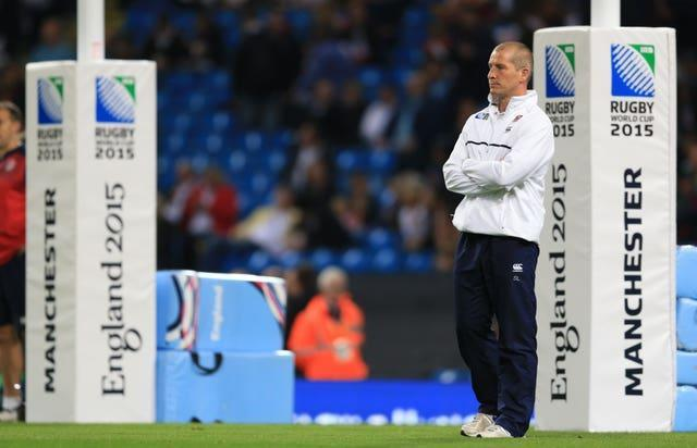 England rugby head coach Stuart Lancaster stands in front of the posts