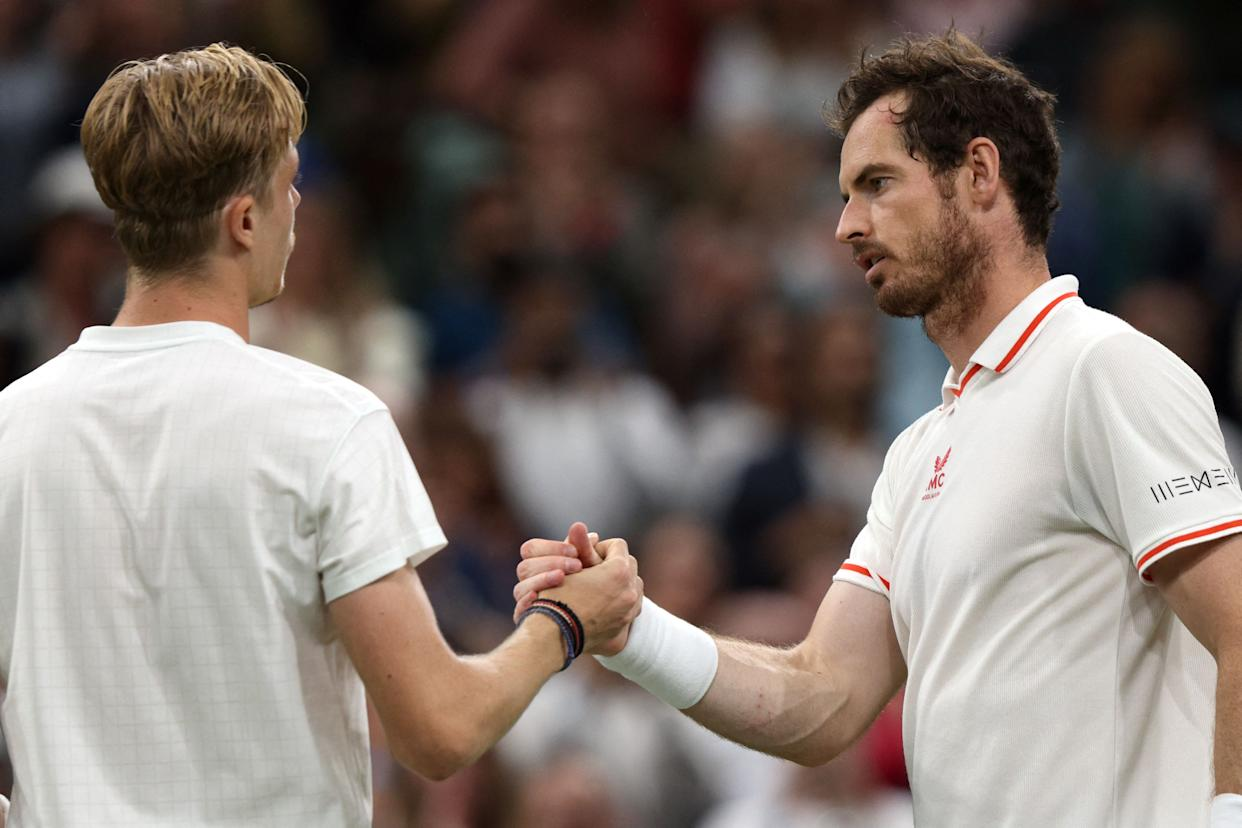 Canada's Denis Shapovalov (L) greets Britain's Andy Murray after winning their men's singles third round match on the fifth day of the 2021 Wimbledon Championships at The All England Tennis Club in Wimbledon, southwest London, on July 2, 2021. - RESTRICTED TO EDITORIAL USE (Photo by Adrian DENNIS / AFP) / RESTRICTED TO EDITORIAL USE (Photo by ADRIAN DENNIS/AFP via Getty Images)