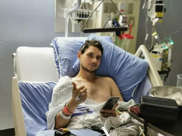 Brian Chipley, 24, recovers in University Hospital after he was shot in the leg during a carjacking on July 7, 2021. (Submitted by Jay Chipley - image credit)