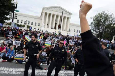 LGBTQ activists and supporters rally outside the U.S. Supreme Court in Washington