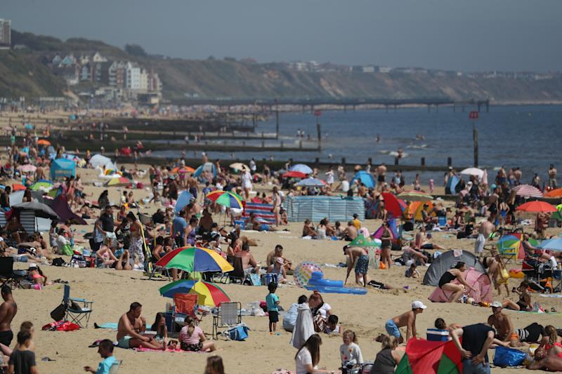 People enjoy the hot weather at Bournemouth beach in Dorset, as people flock to parks and beaches with lockdown measures eased. (Photo by Andrew Matthews/PA Images via Getty Images)