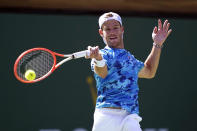 Diego Schwartzman, of Argentina, returns a shot to Cameron Norrie, of Britain, at the BNP Paribas Open tennis tournament Thursday, Oct. 14, 2021, in Indian Wells, Calif. (AP Photo/Mark J. Terrill)