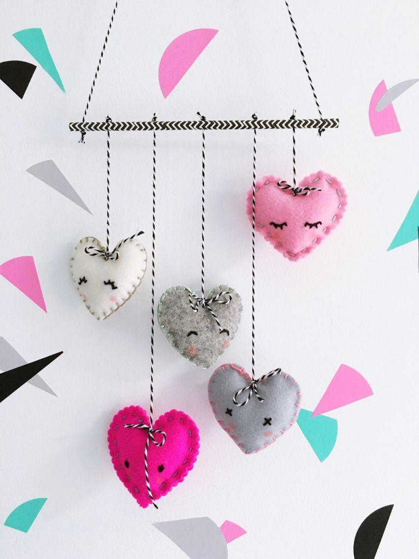 """<p>If you're not a fan of traditional pinks and reds, make a monochrome mobile with white or gray felt. </p><p><em><a href=""""http://sewyeah.co.uk/2016/02/05/make-felt-heart-mobile-or-should-that-be-heartfelt/"""" rel=""""nofollow noopener"""" target=""""_blank"""" data-ylk=""""slk:Get the tutorial at Sew Yeah! »"""" class=""""link rapid-noclick-resp"""">Get the tutorial at Sew Yeah! »</a></em></p>"""