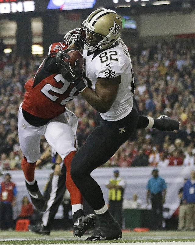 New Orleans Saints tight end Benjamin Watson (82) makes a touch-down catch against Atlanta Falcons free safety Thomas DeCoud (28) during the first half of an NFL football game, Thursday, Nov. 21, 2013, in Atlanta. (AP Photo/David Goldman)