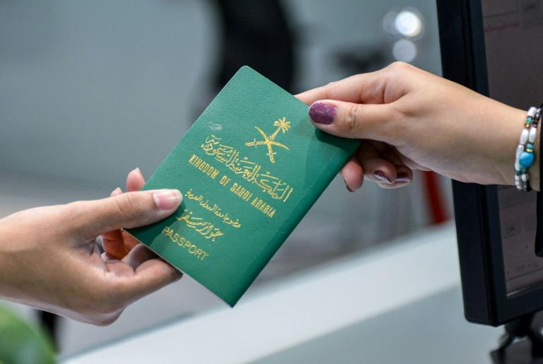 While allowing travel documents, Saudi Arabia has not done away with a legal provision long used to constrain women who leave home without permission (AFP Photo/FAYEZ NURELDINE)