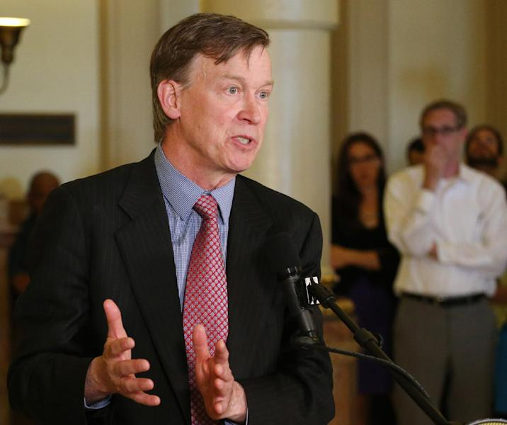 FILE - In this May 22, 2013 file photo, Colorado Gov. John Hickenlooper speaks at a news conference at the Capitol in Denver where he announced that he was granting a temporary reprieve to Nathan Dunlap from his death sentence. An online spot ad from the Colorado Republican Party appeared only hours after Gov. John Hickenlooper last month indefinitely suspended the death sentence of a man who killed four people in 1993 and was scheduled to be executed in August. It is evidence of the slow political re-emergence of crime, what was once a powerful campaign issue that for two decades has been eclipsed by other economic and social issues. (AP Photo/Ed Andrieski, File)