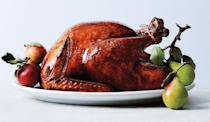 """A little soy sauce in the glaze ensures the burnished mahogany skin that holiday memories are made of. But it's not just for looks; this brined and buttered bird is seasoned inside and out. <a href=""""https://www.bonappetit.com/recipe/glazed-and-lacquered-roast-turkey?mbid=synd_yahoo_rss"""" rel=""""nofollow noopener"""" target=""""_blank"""" data-ylk=""""slk:See recipe."""" class=""""link rapid-noclick-resp"""">See recipe.</a>"""