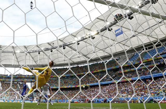 Bosnia's goalkeeper Asmir Begovic (in yellow) looks as the ball hits the crossbar during the team's 2014 World Cup Group F soccer match against Iran at the Fonte Nova arena in Salvador June 25, 2014. REUTERS/Sergio Perez (BRAZIL - Tags: SOCCER SPORT WORLD CUP)